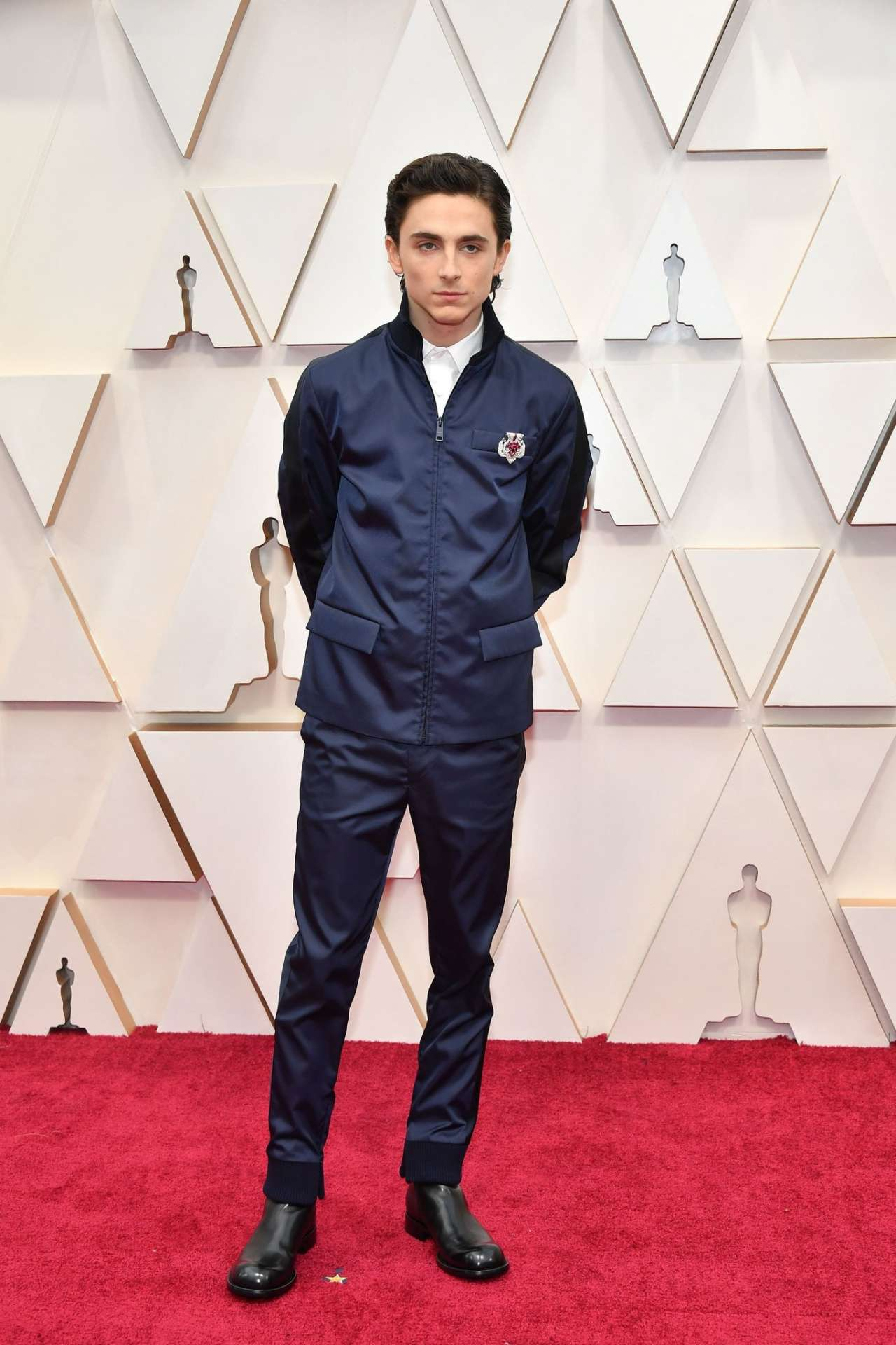 Timothée Chalamet in Prada and Cartier
